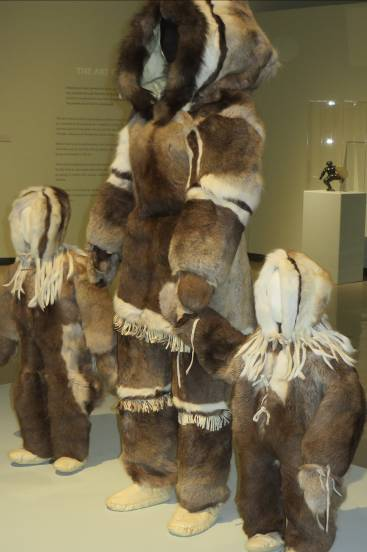 Inuit women's and children's traditional caribou fur clothing from Arctic Canada on display at Winnipeg Art Gallery.  Photo courtesy of D. Ceplis.